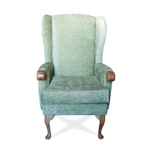 Fully upholstered high back wing chair with knuckles to assist getting in and out of seat